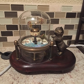 Cat fish in glass dome clock