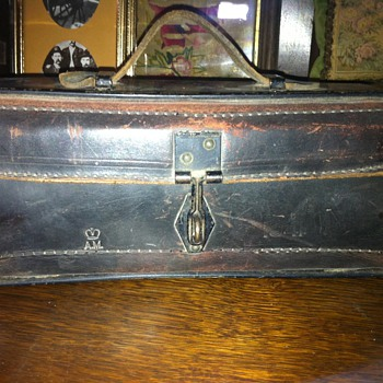 Metal and leather box stamped AM 1941