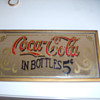 Help to Coca Cola sign