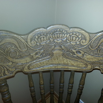 wooden chairs with carved fish on back rest