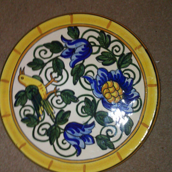 Hand decorated oriental charger - Art Pottery