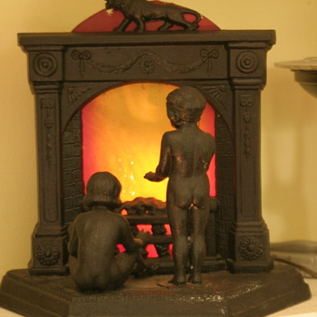 unusual cast iron lamp - fireplace with 2 nude children!!