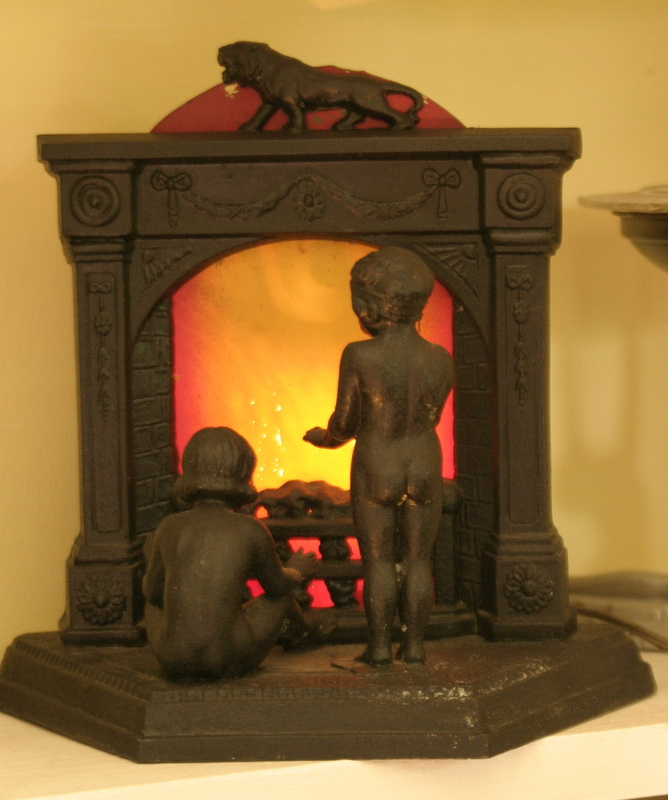 Fireplace Design fireplace lamp : unusual cast iron lamp - fireplace with 2 nude children ...