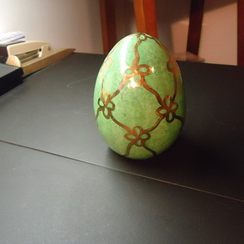 a golden green egg