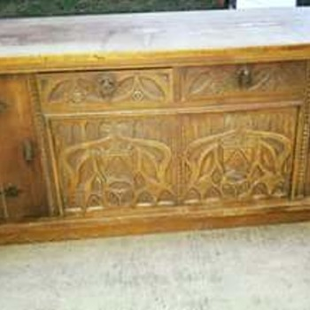 Antique sideboard with amazing details. Any information on this piece?