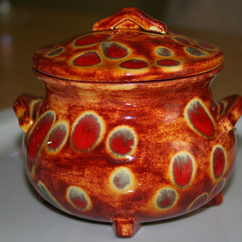 Flaming Orange Tubby pottery with lid. Fire spot glaze