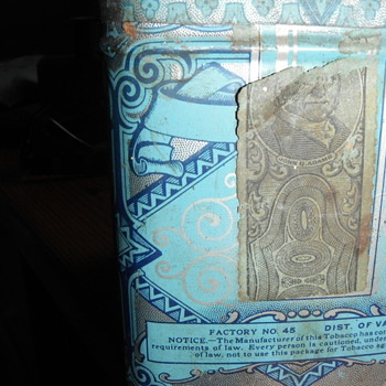 Tobacco tin with John Q. Adams strap and 2 stamps on the bottom