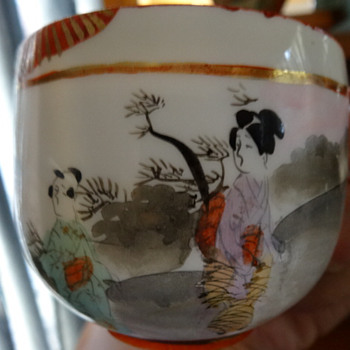"Japanese ""egg shell"" porcelain ""River scene"" cup and saucer"