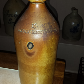 George Reynolds stoneware bottle with star - Bottles