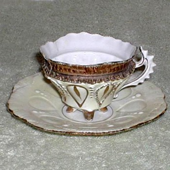 Ivory & Gold Porcelain Demitasse Cup and Saucer