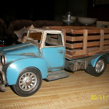 "metal truck with lots of petina!! very old! it measures 6""x16"" wooden box on back (no markings"