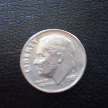 1987P Dime with circle around cheek and effecting the ear,