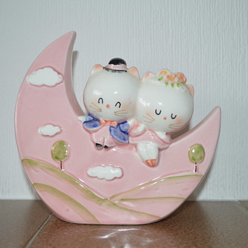 Ceramic money box in the shape of moon with two kitties