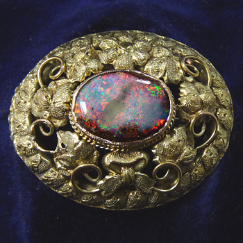 "An Australian ""Goldfields"" Brooch circa 1880, set with a Boulder Opal"