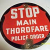 Porcelain Stop sign Main Thorofare Police Order