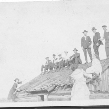 Early family Photo Having Fun on Top of Barn  - Photographs