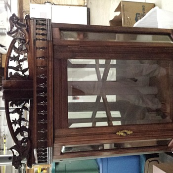 Antique corner curio /beveled glass/top carvings