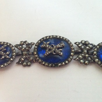 A cobalt blue crystal, silver and marcasite antique necklace.