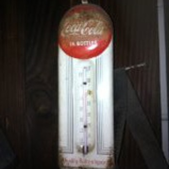 Our Coca-Cola thermometer.  (Trying to find out how old it is...)