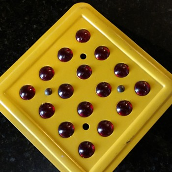Diamond caution sign with marbles
