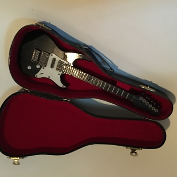 mini electric guitar any informarion