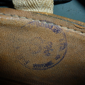 for tinlid, close up photo of stamp in Zukerman helmet