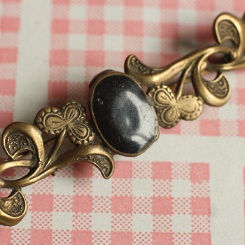 Copper and black enamel art nouveau brooch
