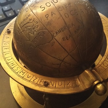 antique brass full form heavy with odd alphabet around it  - Office