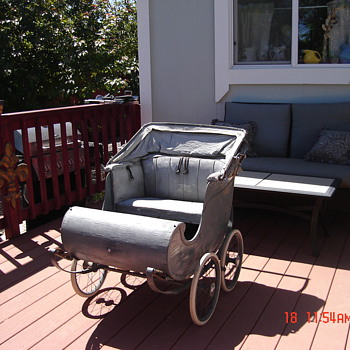 Twin baby carriage.