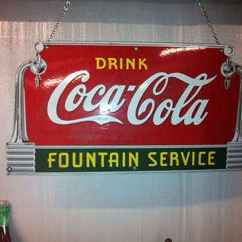 Coca Cola sign from 39, Buick wheels from the 20's,Toms peanut cabinet from 50's