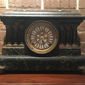 Nothing identifiable on this mantel clock. Information needed.