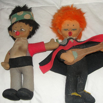 two cloth dolls a hitchhiker and an orange headed guitar player  - Dolls