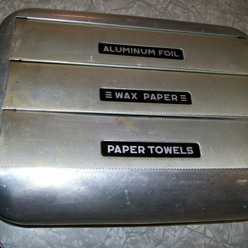 Vintage Wax paper dispenser made of  Aluminum . Original Paper still in it