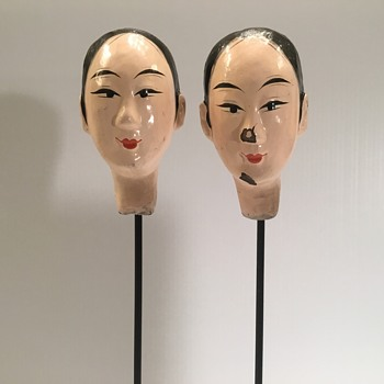 Antique Chinese porcelain heads on a metal stand