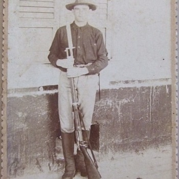 Cabinet card of Spanish American War soldier with his Krag Rifle