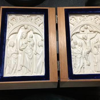 Wooden book with white religious carving inside. What is this?