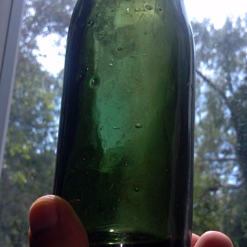 Middle to late 1800s dark green hand blown glass bottle