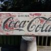 A Pair of Coca-Cola Signs