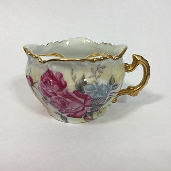 Tea cup with a mustache protector?  Unusual tea cup!