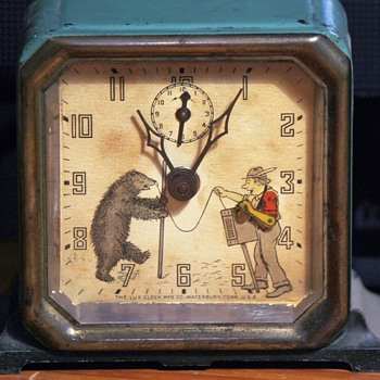 "A Couple Different Variants of Lux ""Organ Grinder"" Alarm Clocks"