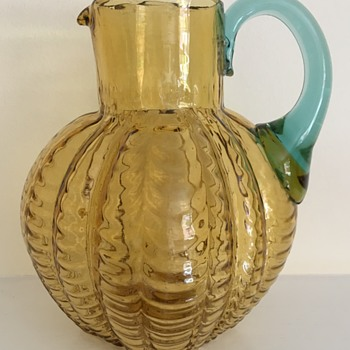 Draped glass jug - amber with blue handle