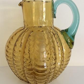 Draped glass jug - amber with blue handle - Art Glass