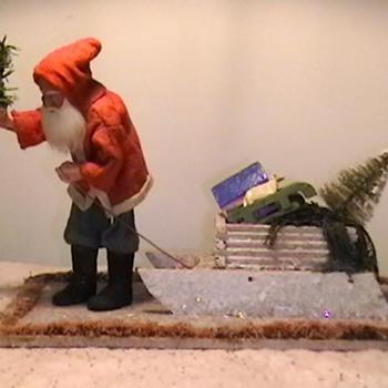 1920's-1930's Santa Pulling a Sled