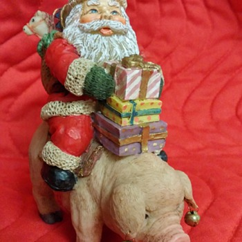 Santa delivering presents on a pig wearing bell earings.