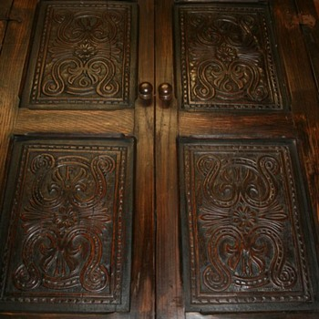 Four 17thC dated 1666 carved panels in a later frame.