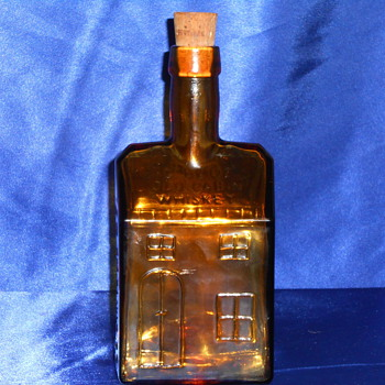 E.C Or E.G BOOZ'S OLD CABIN WHISKEY