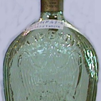 1865 memorial bottle - whiskey - eagle on one side - cannon and stack of balls on opposite side - I am looking for this bottle