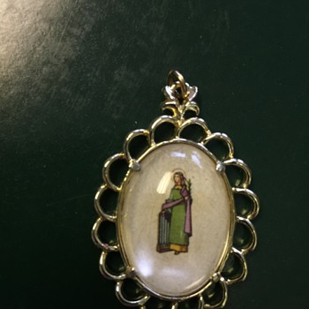 Religious Pendant, but I Can't identify it