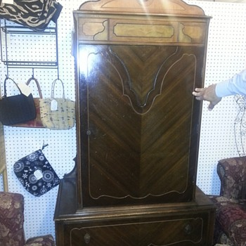 I believe this to be a waterfall wardrobe made by the Lenoir Furniture Corporation.