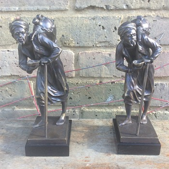 Pair of bronze Arab figures marble bases signed